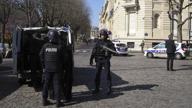 Police officers take position after a letter bomb exploded at the French office of the International Monetary Fund (Thibault Camus/AP)