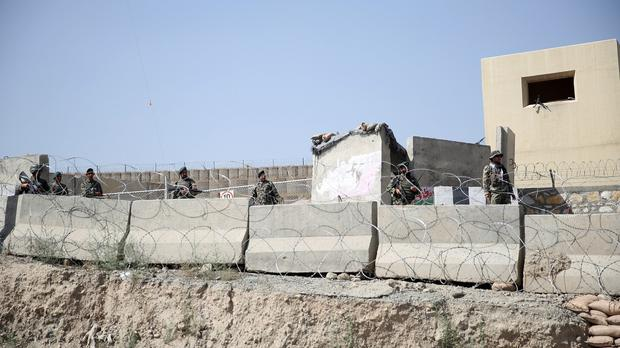 Afghanistan National Army soldiers stand guard at a gate to Camp Qargha, west of Kabul (AP)