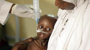 A malnourished child is fed at a centre run by Doctors Without Borders in Maiduguri (AP)
