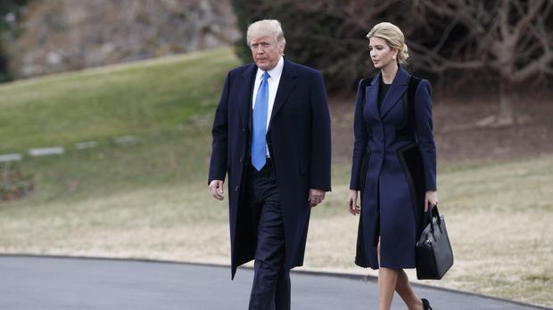Donald Trump and his daughter Ivanka on the South Lawn of the White House (AP)