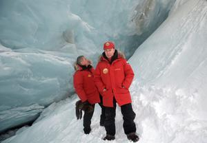 Russian President Vladimir Putin, right, and Defence Minister Sergei Shoigu visit the cave of Arctic Pilots Glacier in the remote Arctic islands of Franz Josef Land, Russia, yesterday. Photo: Reuters