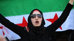An anti-Syrian government protester shouts slogans against president Bashar Assad in Beirut, Lebanon (AP)