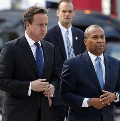 David Cameron toured the memorials in Copley Square accompanied by Massachusetts governor Deval Patrick (AP)