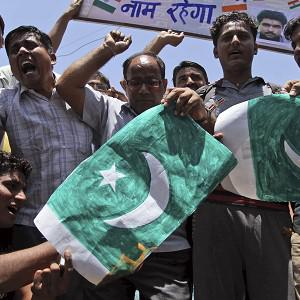 Indians shout slogans and burn a Pakistan flag in Ahmadabad after the death of Sarabjit Singh (AP)