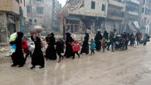 Syrian families fleeing violence in Aleppo's Fardos neighbourhood in December. Photo: Getty