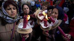 Armenian women during a march to commemorate the 100th anniversary of what many call the first genocide of the 20th century. (AP)