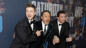 Justin Timberlake, Billy Crystal, center, and Jimmy Fallon attend the SNL 40th Anniversary Special at Rockefeller Plaza (AP)