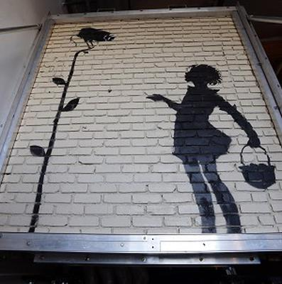 Another Banksy creation, Flower Girl, displayed in a warehouse in Los Angeles (AP)