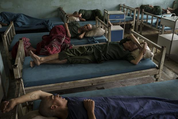 Drug users detained during a Taliban raid rest at the detoxification ward of the Avicenna Medical Hospital for Drug Treatment in Kabul (AP)