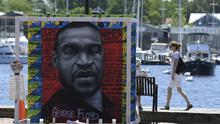 A person walks by a memorial to George Floyd in Susan Campbell Park in Annapolis (Susan Walsh/AP)