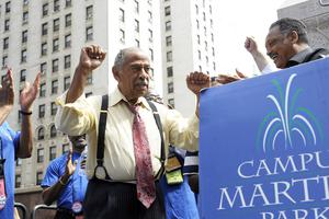 John Conyers greets the Rev Jesse Jackson at a postal workers' rally in 2010 (AP)