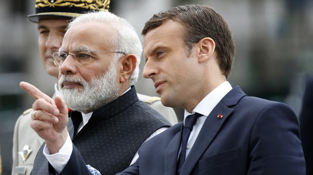 Indian Prime Minister Narendra Modi and French President Emmanuel Macron attend a ceremony at the Arc de Triomphe in Paris (AP)