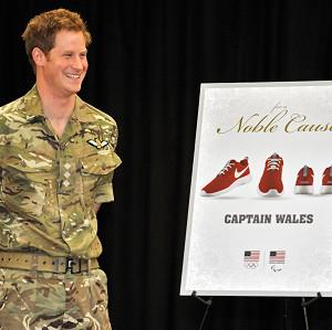 Prince Harry is presented with personalised Nike trainers at a reception and brunch at the start of the Warrior Games