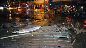A debris-strewn street in Valparaiso, Chile, after a tsunami caused by an huge earthquake hit the area (AP)