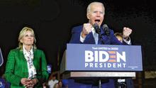 Roaring back: Joe Biden and his wife Jill enjoy a rally with supporters in Los Angeles. Photo: Marcio Jose Sanchez/AP
