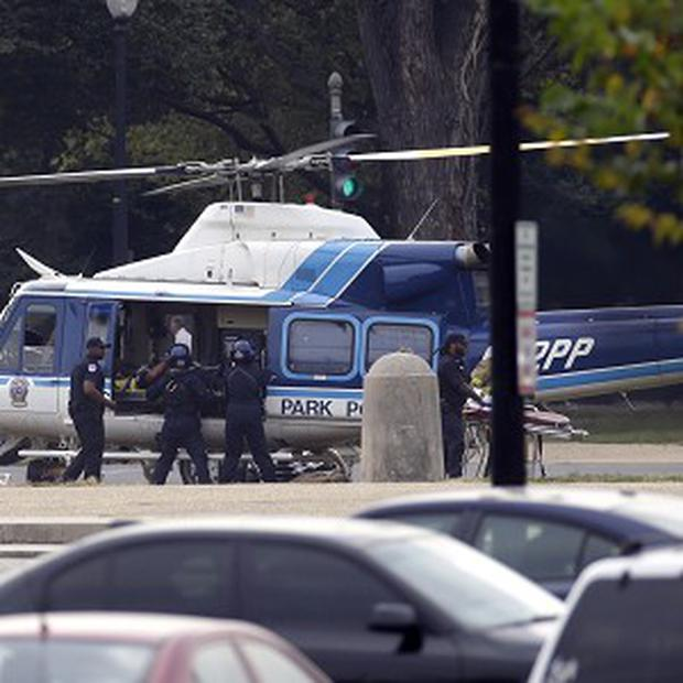 A US Park Police helicopter is loaded on the Mall in Washington with a victim from a shooting (AP)