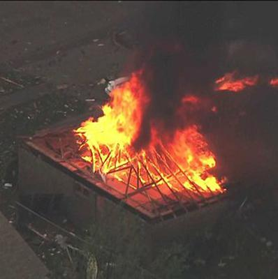 A house fire outside Moore, Oklahoma, after a tornado as much as a mile wide roared through the city suburbs (AP/KFOR-TV)