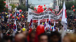 Thousands of people march in protest amid a 24-hour nationwide general strike, in Athens (AP)