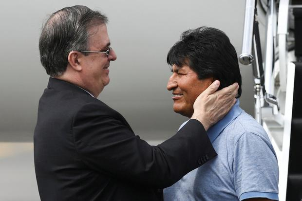 Evo Morales (right) is greeted by Mexico's foreign minister. Photo: Edgard Garrido/Reuters