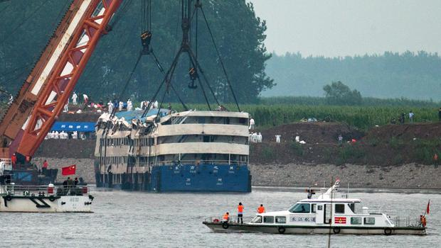Medical workers make preparations near the capsized Eastern Star ship, as it is lifted by cranes on the Yangtze River (AP)