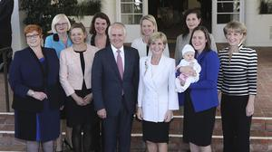 Malcolm Turnbull poses for photos with female members of his government after they were sworn in at Government House in Canberra (AP)