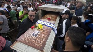 Relatives and friends carry the coffin of the Maria Jose Alvarado, 19, during her burial (AP)