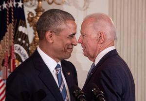 Close friends: Joe Biden and Barack Obama walk past each other at the White House in January 2017 during Mr Obama's time in office