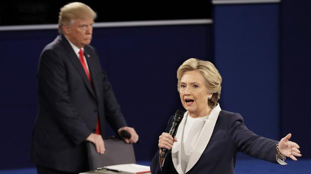 Hillary Clinton walks past Donald Trump during the debate (AP)