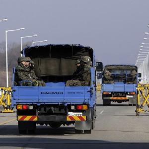 South Korean military vehicles carrying soldiers pass at barricaded Unification Bridge near the border village of Panmunjom (AP)