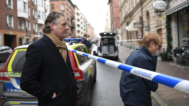 Peder Enstrom, the owner of Couleur gallery stands by as police work at the scene after items were stolen from an exhibition at the gallery in Stockholm (Ali Lorestani/TT News Agency/AP)