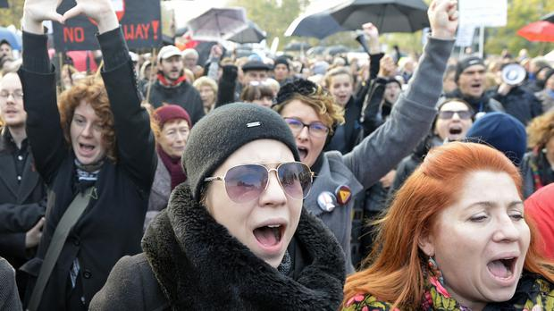 Protesters during a rally in front of the parliament in Warsaw, Poland (AP)