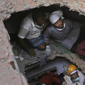Rescue workers search for survivors in a building that collapsed on Wednesday (AP)