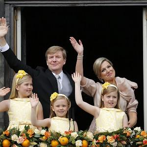 King Willem-Alexander and Queen Maxima appear on the balcony of the Royal Palace in Amsterdam with their children, Catharina-Amalia, Ariane and Alexia (AP)
