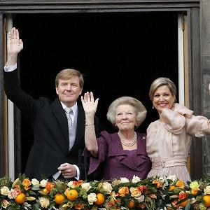 Dutch King Willem-Alexander, Queen Maxima, right, and Princess Beatrix appear on the balcony of the Royal Palace in Amsterdam (AP)