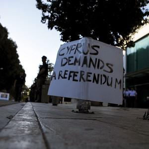 A banner displayed, during an anti-bailout protest outside Cyprus' parliament building (AP Photo)