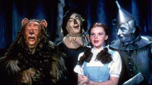 The Cowardly Lion costume worn by Bert Lahr, far left, in The Wizard Of Oz is up for auction (Warner Bros/AP)