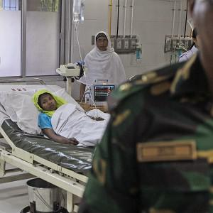 Reshma Begum, who survived 17 days before being rescued from a collapsed garment factory building, receives treatment at a hospital in Savar, near Dhaka, Bangladesh (AP)