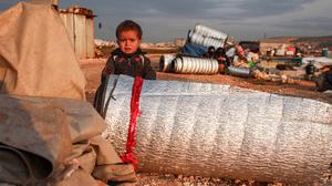 Danger zone: A child at a refugee camp in Idlib, which was expected to be abandoned. Photo: Getty