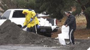 Local residents brave heavy rain to fill sandbags, near the Truckee River in Sparks, Nevada