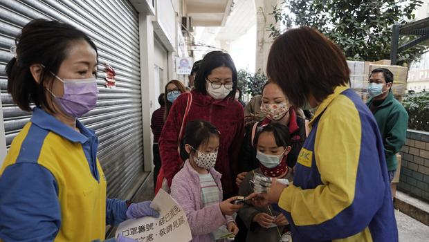 People queue up to buy face masks in Hong Kong (Kin Cheung/AP)