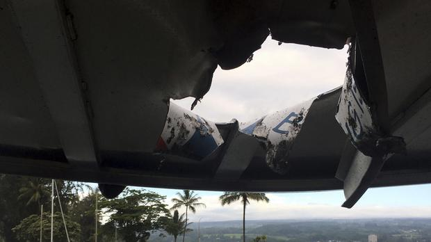 Damage to the roof of the tour boat after an explosion sent lava flying off the Big Island of Hawaii (Hawaii Department of Land and Natural Resources via AP)