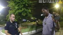 This screen grab taken from body camera video provided by the Atlanta Police Department shows Rayshard Brooks speaking with Officer Garrett Rolfe in the car park (Atlanta Police Department via AP)