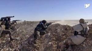 Fighters from the SDF opening fire on an Islamic State group's position (Syria Democratic Forces, via AP)