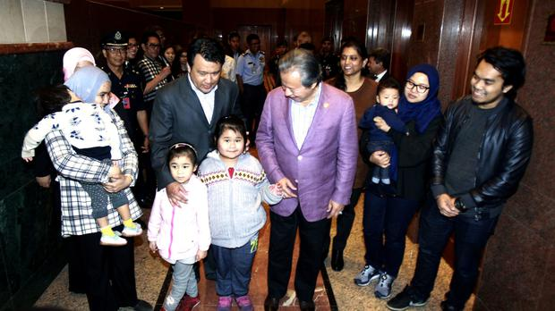 Malaysia's foreign minister Anifah Aman with the nine Malaysians who were returned from Pyongyang (AP)