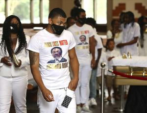 Family members and friends wear all white(Curtis Compton/Atlanta Journal-Constitution via AP)
