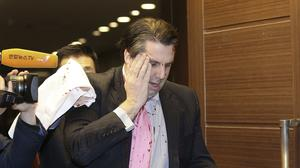 US Ambassador to South Korea Mark Lippert leaves a lecture hall in Seoul after being attacked by a man (AP/Yonhap)