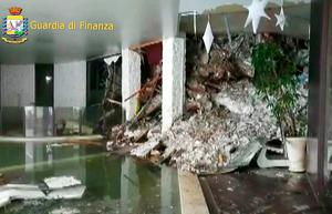 A wall of snow engulfing the inside of the Hotel Rigopiano. Photo: AFP/Guardia di Finanza