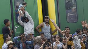 A train full of migrants being held at Bicske, Hungary. (AP)
