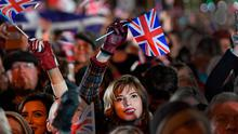 A LEAP IN THE DARK: British subjects fly the flag in London on Friday