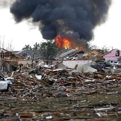 A fire burns in the Tower Plaza Addition in Moore, Oklahoma following a tornado (AP/Sue Ogrocki)